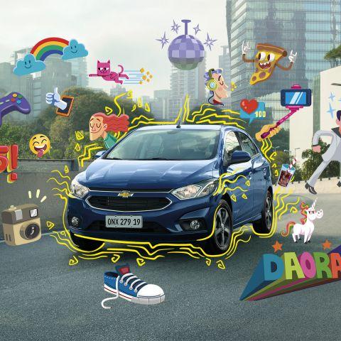 Chevrolet envolto de ilustrações. Entre elas: rosto feliz, joinha, controle de video-game, nuves com arco-íris, gato rosa, globo de vidro, pizza, unicórnio, um tênis e a palavra DAORA