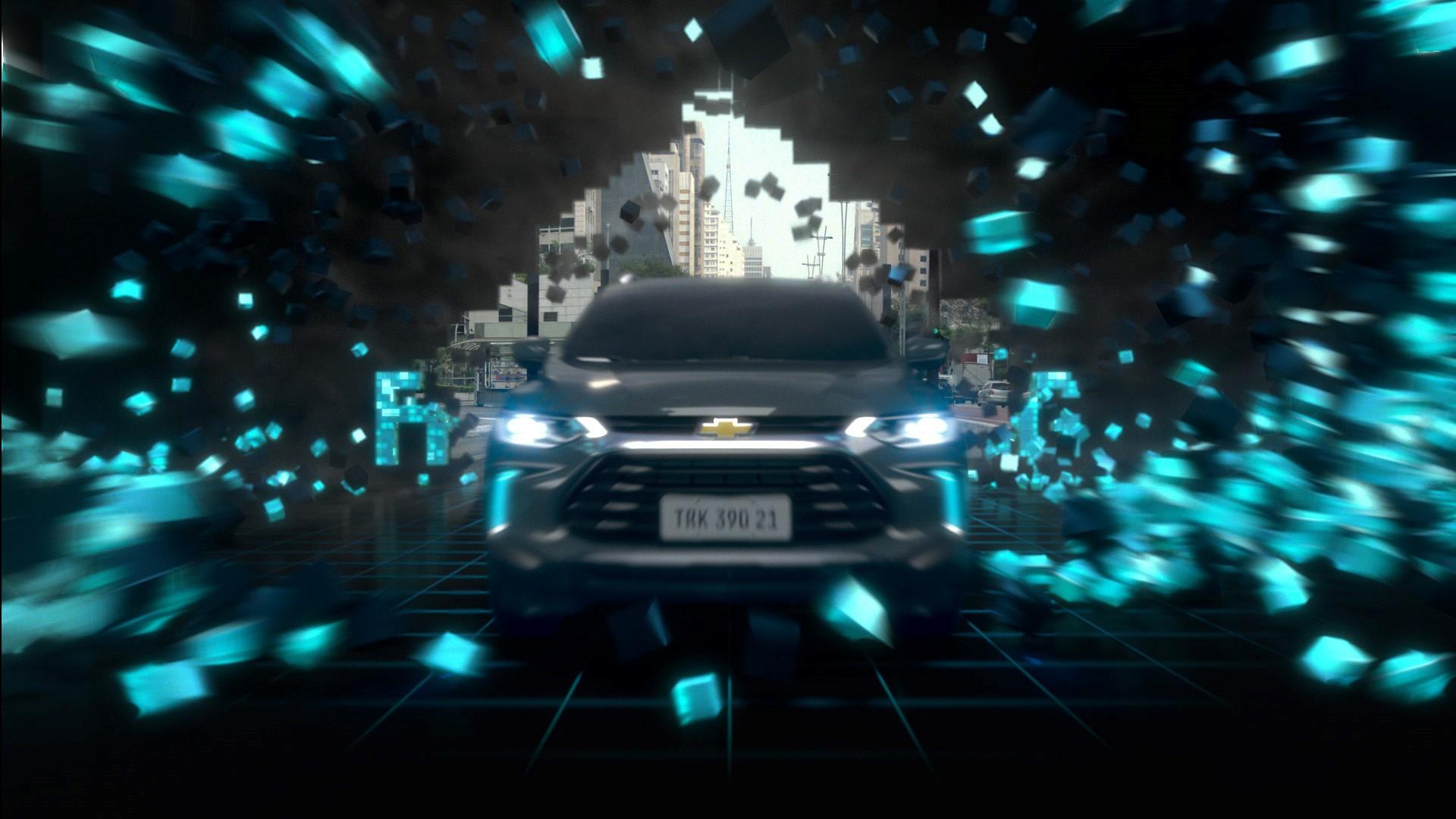Na imagem, o Novo Chevrolet Tracker aparece como se estivesse saindo de um jogo de vídeo game